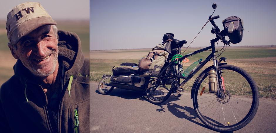 Man sieht Jean-Claude die Reiseerfahrung an, sowohl im Gesicht, als auch am Fahrrad.